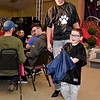 "(Brad Davis/The Register-Herald) Jayden Straughn and Maverick Davis set out to meet the crowd during the 2020 Hunks in Heels ""Fur"" Real fundraising event at the Beckley Moose Lodge."