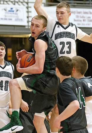 (Brad Davis/The Register-Herald) Wyoming East's Zachary Cook pulls down a critical defensive rebound late in the Class AA Region 3, Section 1 championship game against Westside Saturday night at the Beckley-Raleigh County Convention Center.