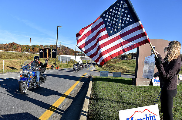 "(Brad Davis/The Register-Herald) U.S. Senator Joe Manchin, left, waves to supporters as he and a pack of about 20-30 riders rumble into the Tamarack Travel Center in Beckley Sunday morning, the first of 12 scheduled stops along a statewide motorcycle tour dubbed the ""Take Me Home"" ride. Their journey began at Charleston's Cultural Center, stopped first in Beckley then headed south towards Lewisburg, Marlinton, Elkins and Romney before capping the first of the two-day ride in Martinsburg. Today, the senator and anyone who decided to join the ride along the way will roll through Morgantown, Fairmont and Bridgeport before ending the ride and his mid-term election campaign back in Charleston."