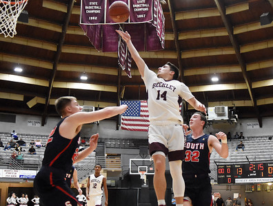 Woodrow Wilson's Bryce Radford (14) goes up for a layup over Parkersburg South's (22) during the first quarter of their basketball game in Beckley Tuesday. (Chris Jackson/The Register-Herald)