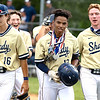 Tyler Mackey wearing the medals  hit his first High School Homerun for Shady Spring tonight in the Sectional game against Nicholas County,  from left to right, Evan Belcher, Parker Redden Tyler Mackey Josh Lovell.<br /> TINA LANEY/for The Register-Herald