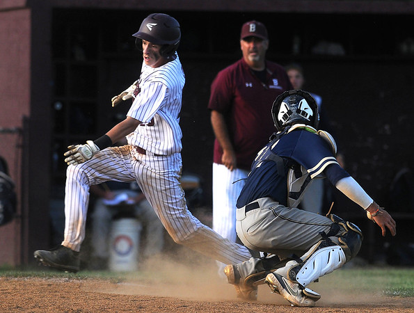 Woodrow's Connor Mollahan avoids the tag of Shady catcher Parker Redden providing Woodrow's first lead of the game. 9-8. Jon C. Hancock/for The Register-Herald