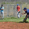 (Brad Davis/The Register-Herald) Infielder Aden Seabolt takes his turn fielding ground balls as Shady Sharks teammates Hayden Johnson, background left, and Evan Sinclair watch during a practice Sunday afternoon at the Beckley Little League fields.