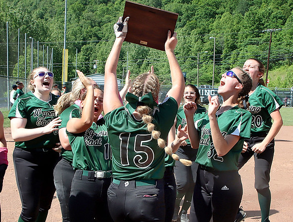 The Wyoming East Lady Warriors celebrate their sectional win over Bluefield.