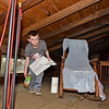 (Brad Davis/The Register-Herald) Small enough to access the cramped areas and not being afraid of a few cobwebs made Bradley Elementary student council treasurer Rylan Ellison perfect for the tough job of cleaning the attic of Wildwood House Saturday afternoon.