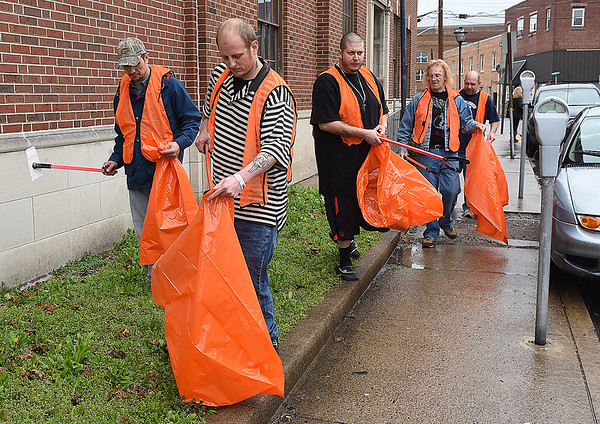 Southern West Virginia Fellowship Home members help clean up Woodlawn Ave. in Beckley.<br /> (Rick Barbero/The Register-Herald)