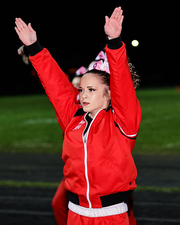 An Oak Hill Red Devil cheerleader gets the crowd fired up during a time out. Chad Foreman for the Register-Herald.
