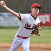 (Brad Davis/The Register-Herald) Oak Hill starting pitcher Caleb Jones delivers during the Red Devils' game against Wyoming East Friday evening in Oak Hill.