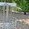(Brad Davis/The Register-Herald) Disc golfer Austin Buckland finishes up a hole on a brand new disc golf course at Daniel Vineyards Friday afternoon.