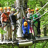 Member of the Freelance Council of the Society of American Travel Writers, participated in the TreeTops Zipline Canopy Tours at Adventure On The Gorge Wednesday morning. Forty-one Travel Writers are exploring and writing about West Virginia this week.<br /> (Rick Barbero/The Register-Herald)