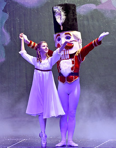 (Brad Davis/The Register-Herald) Clara, played by Louie Boyd, dances with the Nutcracker Prince, played by Gregory Brown, after slipping into dreamland during a scene from Beckley Dance Theatre and Beckley Performing Arts' presentation of The Nutcracker Sunday afternoon inside the Woodrow Wilson High School Auditorium.