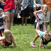 Girls and Boy participating in the wheel barrel race at the Alderson 4th of July celebration.<br /> Tina Laney/for The Register-Herald