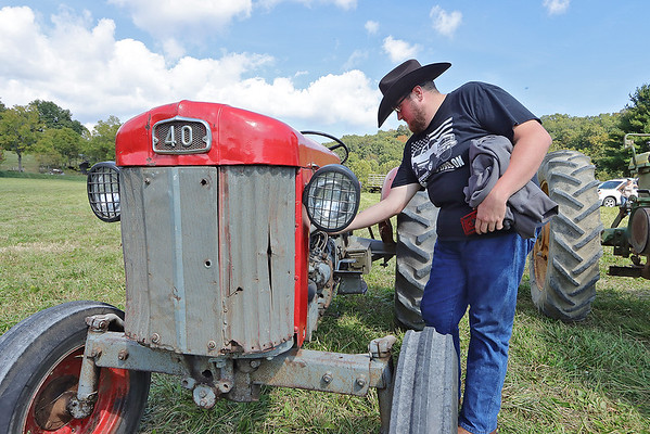 Tahoe Tractor Club member Caleb Alder checks out an old tractor after riding in the Antique Tractor Ride Saturday in Alderson. Jenny Harnish/The Register-Herald