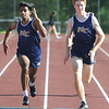 Shiv Patel and Levi Miner,  Nicholas county runners, compete in a 200 meter heat at WWHS. Miner finished first and Patel finished second in the heat. Jon C. Hancock/for The Register-Herald