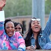 Rita Powell, left, and Shawnte Powell cheer for thier daughter and sister graduating from Woodrow Wilson High School at the 95th annual commencement ceremony in Beckley Saturday.  Jenny Harnish for the Register-Herald