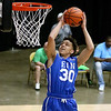 (Brad Davis/The Register-Herald) Team EIN's (Class AAA) Eddie Christian soars to the basket for an easy layup off a breakaway against Team Mid-State Ford (National) during the Scott Brown Classic Saturday night at the Beckley-Raleigh County Convention Center.