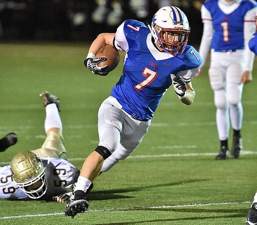 (Brad Davis/The Register-Herald) Midland Trail's Colton Yoder dodges Williamstown's Brady Ankrom as he picks up yards Friday night in Fairlea.