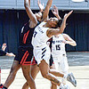 Concordia University's J'may Simmons, left, and WVU Tech's Makavia jones fights for a rebound during Saturday afternoon action in Beckley. F. Brian Ferguson