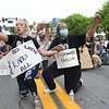 """Chloie Delp, left, and Joyce McCormick, both from Lewisburg, took a knee along with many others for nine minutes on Washington Street in Lewisburg, chanting """"George Floyd I can't breath."""" They were Protesting against racism and police brutality.<br /> (Rick Barbero/The Register-Herald)"""