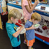 F. Brian Ferguson/Register-Herald  Abraham ,4, Soloman, 2, and Laila Richman enjoy the flavors of Melting Memories Ice Cream on Friday afternoon.