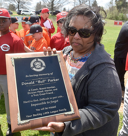 """(Brad Davis/The Register-Herald) Norma Parker, wife of the late Donald """"Bull"""" Parker, shows the special plaque she and family on hand received after he was honored during opening ceremonies at Beckley Little League Park Saturday afternoon."""