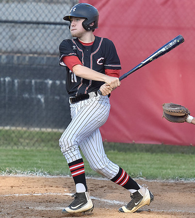(Brad Davis/The Register-Herald) Greater Beckley Christian's William Mullins drives a pitch deep against Mount View Wednesday evening at Park Middle School.
