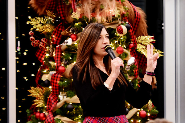 Michelle Rotellini, executive director of United Way of Southern West Virginia, speaks during the 11th annual United Way of Southern West Virginia's Wonderland of Trees Auction at the J.W. And Hazel Ruby West Virginia Welcome Center in Mt. Hope on Friday. (Chris Jackson/The Register-Herald)