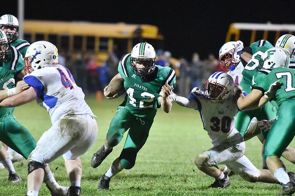 Fayetteville's Calvin Endicott (42) carries past Midland Trail's Tyler Brasse (30) during their high school football game Friday in Fayetteville. (Chris Jackson/The Register-Herald)