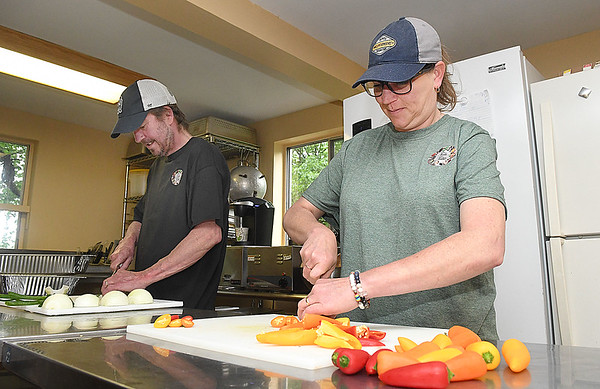 John and Tabitha Henderson, owners of Tabs Table, operate a catering service out of Athena Farm and Vineyard's kitchen.<br /> (Rick Barbero/The Register-Herald)