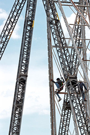 A worker puts together a ride at the State Fair of West Virginia Friday. Jenny Harnish/The Register-Herald