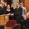 Fayette County circuit court judge Paul Blake, left, swears in Thomas H. Ewing, third from left, as the new Fayette County judge appointed by Governor Jim Justice. Ewing replaced John W Hatcher Jr. who recently retired. Standing with Ewing is his wife Lauri, second from left, holding the bible and children, Seth, Ty, Mindy and Jacob Ewing.<br /> (Rick Barbero/The Register-Herald)