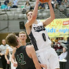 (Brad Davis/The Register-Herald) Shady Spring's Tommy Williams drives and scores as Wyoming East's Anthony Martin defends on Big Atlantic Classic Championship Saturday at the Beckley-Raleigh County Convention Center.