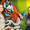 Shady Spring High School art students Serenity Brooks and Madison Day stand with the art they created for the cafeteria of the school.  Jon C. Hancock/for The Register-Herald