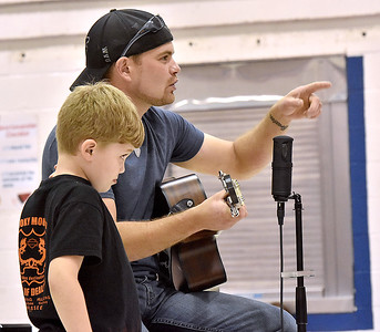 (Brad Davis/The Register-Herald) Coal City resident and local country musician Thomas Danley prompts the crowd to sing happy birthday for his 9-year-old son Sawyer, a 2nd-grader, during the closing moments of a special show for youngsters at Coal City Elementary Friday afternoon. Danley, who has played alongside fellow local musician Cody Wickline, may end up taking a crack at The Voice in the future but for now is working on putting together a band and hopes to spend the next year on those efforts.