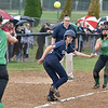 (Brad Davis/The Register-Herald) Greenbrier West baserunner Amanda Church gets caught in a rundown between home and third as Fayetteville infielders Carrie Taylor, far left, and Nikki Holbrook track her down for the out Wednesday night in Fayetteville.
