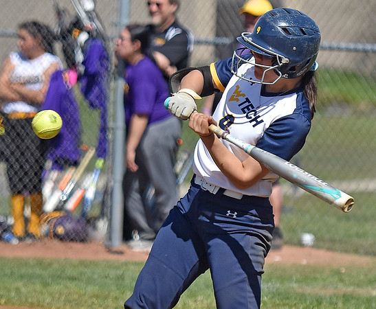 (Brad Davis/The Register-Herald) WVU Tech's Olivia Morey takes a cut during the 6th inning of the Golden Bears' game against Carlow University Saturday afternoon at Woodrow Wilson High School.