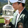 Xander Schauffele kisses his trophy after the winning after winning The Greenbrier Classic.<br /> (Rick Barbero/The Register-Herald)