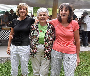 (Brad Davis/The Register-Herald) From left, Patti Burwell, Rose Marie Brown and Mary Ellen Childress take a few moments from assisting with the picnic to grab a quick photo during the annual Memorial Day picnic at the 140-year-old Sacred Heart Catholic Church in Meadow Bridge.