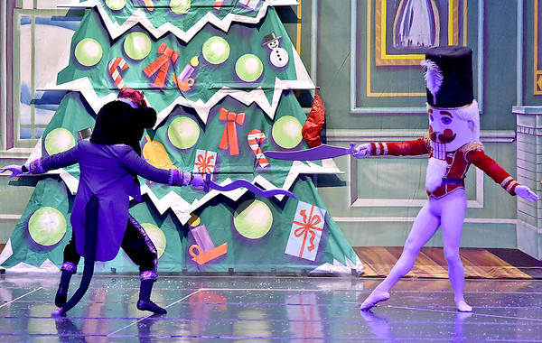 (Brad Davis/The Register-Herald) The Nutcracker Prince, played by Gregory Brown, battles the King Rat, played by Rodney Hairston, during a scene from Beckley Dance Theatre and Beckley Performing Arts' presentation of The Nutcracker Sunday afternoon inside the Woodrow Wilson High School Auditorium.