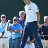 Kevin Na smiles and gets a reaction from a spectator after sinking his par putt on the par 5, 17th  during A Military Tribute at The Greenbrier golf tournament held at The Greenbrier Resort in White Sulphur Springs.<br /> (Rick Barbero/The Register-Herald)