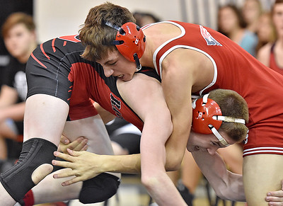 (Brad Davis/The Register-Herald) Liberty's Tyler Price takes on Independence's Phil Spurlock in a 120-pound weight class matchup Saturday afternoon at the Raider Rumble in Glen Daniel. Liberty's price won the match.