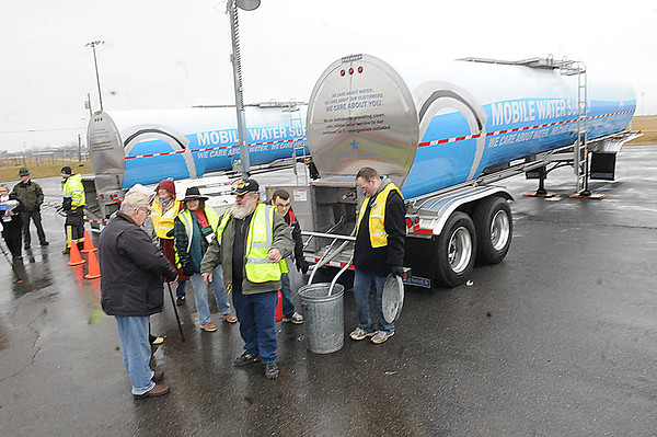 Rick Barbero/The Register-Herald Residences of Lewisburg get water at the State Fair grounds in Fairlea Monday morning because of a diesel spill in Alvin.