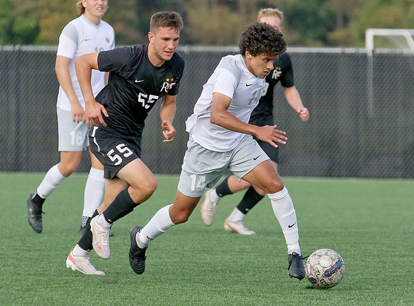 (Brad Davis/For The Register-Herald) WVU Tech's Abdelrahman Rabie battles for possession with Rio Grande's Caio Mazzo Nogueira Saturday afternoon at the YMCA Paul Cline Memorial Sports Complex.