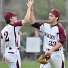 (Brad Davis/The Register-Herald) Woodrow Wilson starting pitcher Hunter Fansler, right, gets a high-five from teammate Callan Bates after striking out his 17th batter and being lifted for a reliever in the top of the 7th due to pitch count Wednesday evening in Beckley.