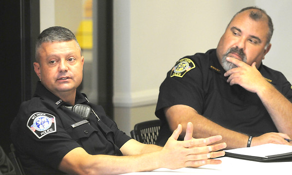 Sammuel Jasper, Mt Hope patrolman, speaks to Attorney General Patrick Morrisey during a meeting with law enforcement about the surge in Fentanyl in Raleigh and Fayette counties. Jon C. Hancock/for The Register-Herald
