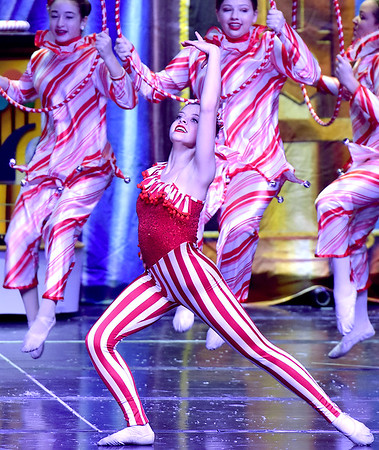 (Brad Davis/The Register-Herald) The Czarina, played by Carsyn Harris, dances with her fellow Russian Candy Canes during a scene from Beckley Dance Theatre and Beckley Performing Arts' presentation of The Nutcracker Sunday afternoon inside the Woodrow Wilson High School Auditorium.