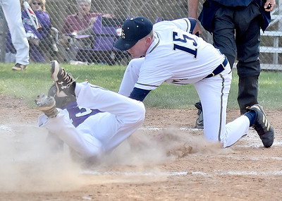 (Brad Davis/The Register-Herald) Shady Spring pitcher Justin Lovell tags out James Monroe baserunner Peyton Whitt as he tries to score after a passed ball Wednesday evening in Shady Spring.
