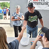 (Brad Davis/The Register-Herald) West Virginia Miners fans Charles and Phyllis Massie of Cool Ridge hand their tickets to gatekeepers Kaylee Hughes, left, and Cat Fauber prior to the start of the team's season opener against the Kokomo Jackrabbits Wednesday evening at Linda K. Epling Stadium.