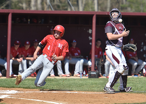 (Brad Davis/The Register-Herald) Woodrow Wilson catcher Jacob Lovell loses sight of the ball after the throw bounces off him while Hurricane's Chandler Kelley slides home Saturday afternoon in Beckley.