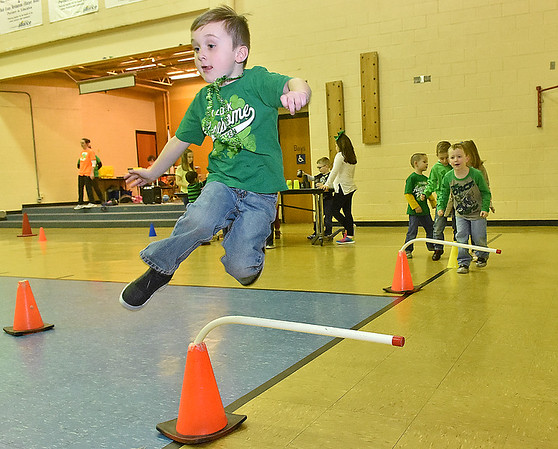 (Brad Davis/The Register-Herald) Kindergartener Ayden Ruble clears another obstacle as he jumps away some extra energy during Maxwell Hill Elementary's Jumping for Hearts event Friday afternoon in the school's gymnasium. Students spent several days gathering donations for the American Heart Association by sending out e-mails, asking friends and family or even going door-to-door in their neighborhoods if they wised, raising around $5,000 overall. The annual event concluded with a special celebration in the gym where students got to run and play in a variety of jumping-related activities.